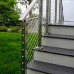 Photo of an exterior stair with cable railing.