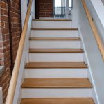 Photo of a commercial stair in a renovated factory building.