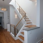 Photo of a stair with cable railing in a modern home.