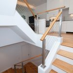Stair with cable railing in a modern home.