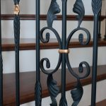 Close-up photo of a wrought iron baluster.