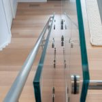 Stair with glass railing in a modern home.