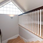 Photo of a guardrail with wood balusters and a custom newel post.