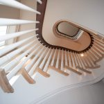 Photo taken from below of a multi-level curved staircase.