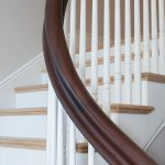 Photo of a curved handrail.