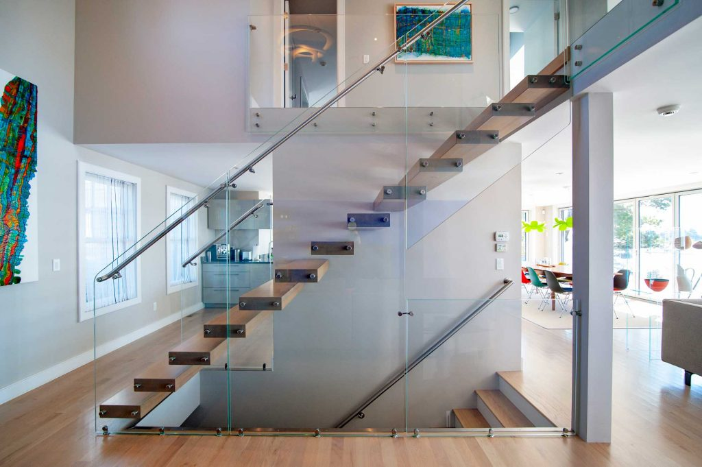 photo of marretti stair with floating treads and glass balustrade