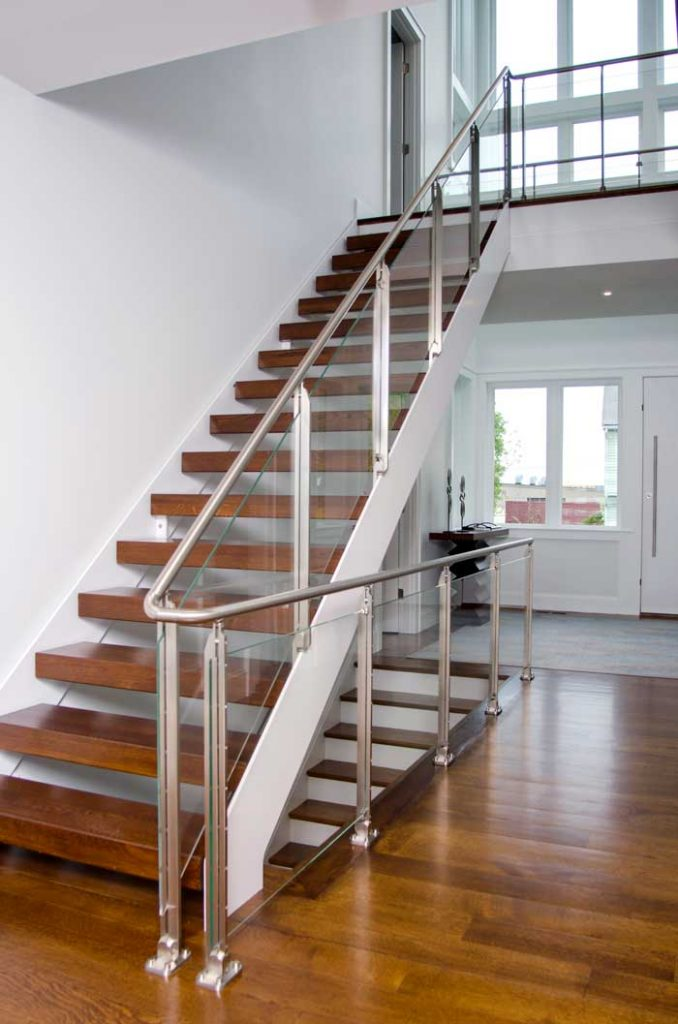 photo of Marretti stair floating treads, stainless, rail and glass panels