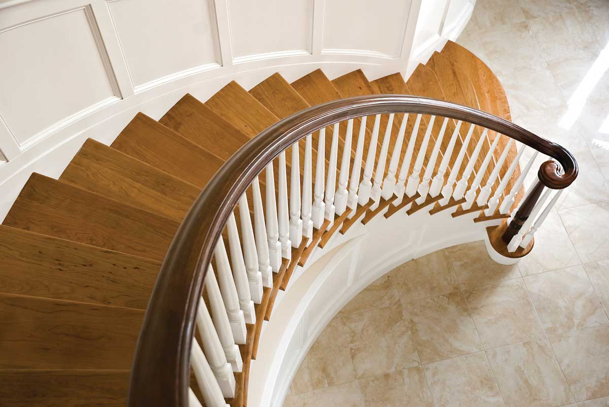 photo of curved stair custom handrail