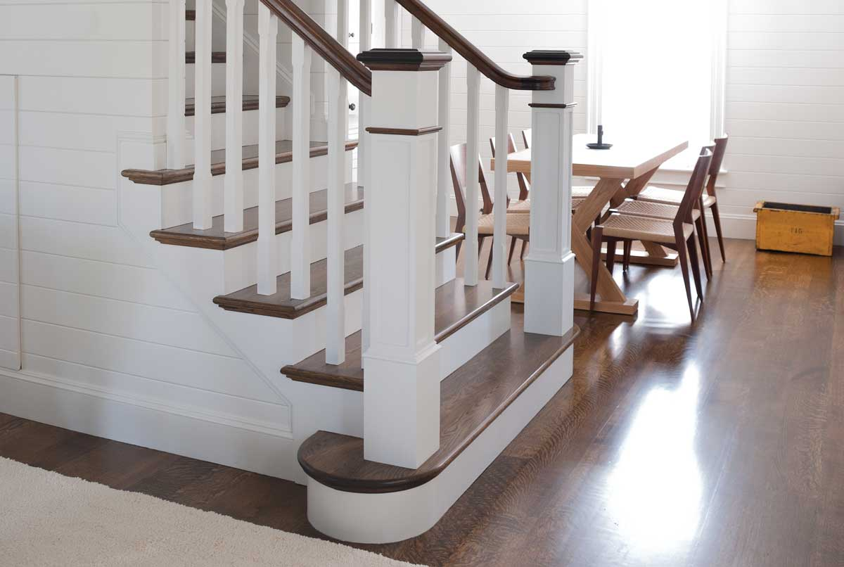 photo of stair with box newels and dark treads